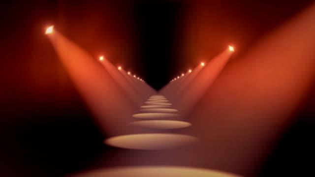vidéos et rushes de projecteurs dans le couloir boucle de fond rouge - podium de défilé