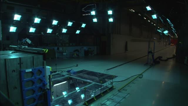 spotlights shine inside a crash test laboratory. - crash test stock videos & royalty-free footage