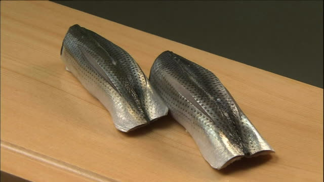 spotted shad covers a pair of nigiri ovals. - nigiri stock videos and b-roll footage