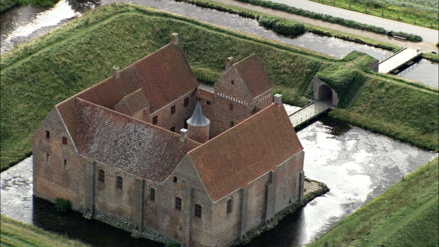 spottrup slot  - aerial view - central jutland,  skive kommune,  denmark - moat stock videos and b-roll footage