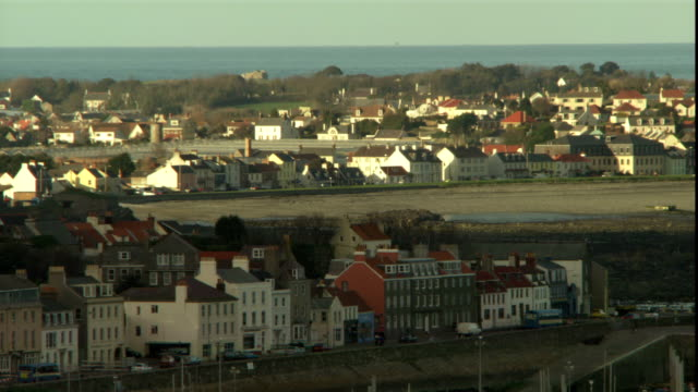 a sprawling english town is framed by the english channel. - channel islands england stock videos & royalty-free footage