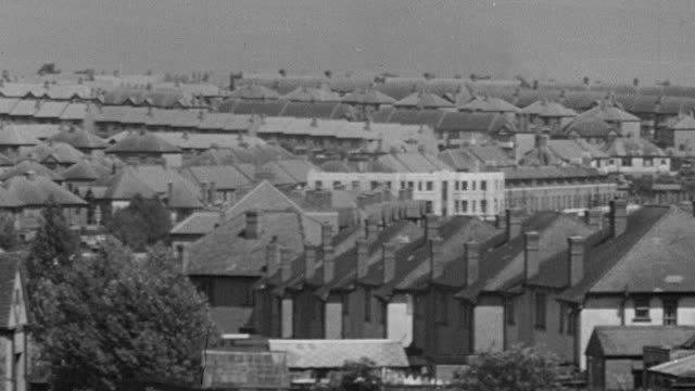 1945 b/w pan sprawling mass suburban housing / coventry, west midlands, england - rebuilding stock videos & royalty-free footage