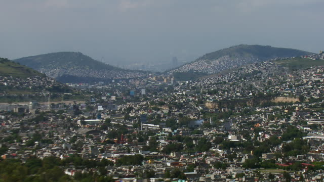 Sprawling view of Mexico City fading into a haze.