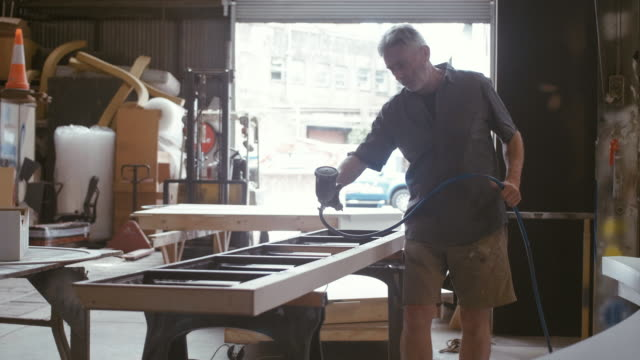 spray painter (slow motion) - spray painting stock videos & royalty-free footage