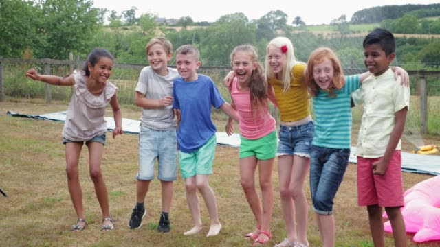sprayed by garden sprinkler - children only stock videos & royalty-free footage