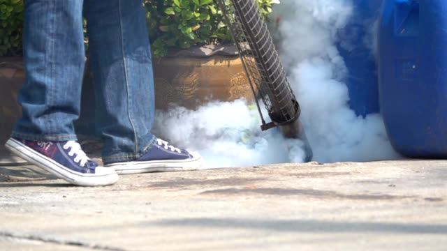 spraying mosquito machine, getting rid of aedes mosquitoes. slow motion - pest stock videos & royalty-free footage