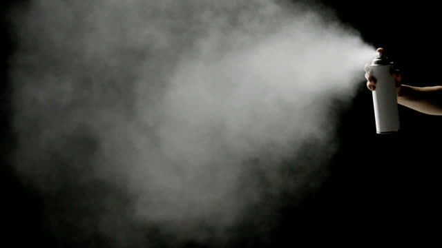 spraying on black background - aerosol can stock videos & royalty-free footage