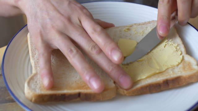 spread butter on white toast