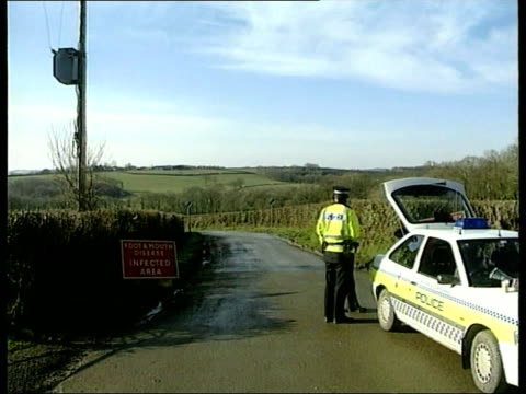spread continues itn england devon gv police car blocking entrance to lane leading to foot and mouth infected farm gv farm ls jcb digger excavating... - trench stock videos and b-roll footage