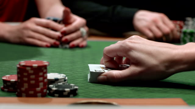 hd: spreading cards on a poker table - casino worker stock videos and b-roll footage