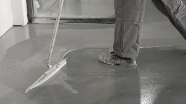 spreading glue on resin floor coating - polishing stock videos & royalty-free footage