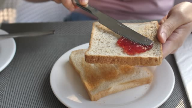 spreading jam on a slice of bread - gelatin stock videos & royalty-free footage