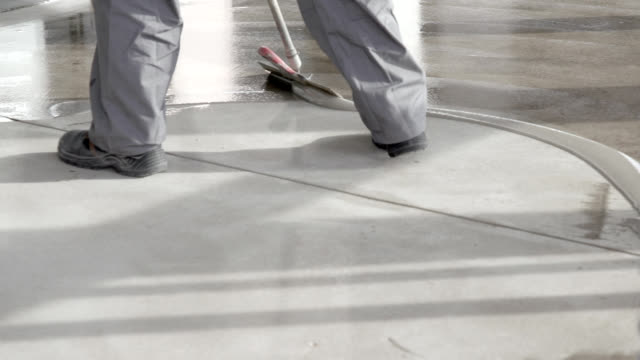 spreading liquid protective layer on cement floor - flooring stock videos & royalty-free footage