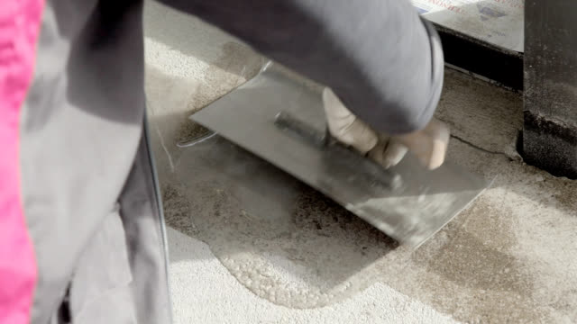 spreading resin on cement floor - flooring stock videos & royalty-free footage