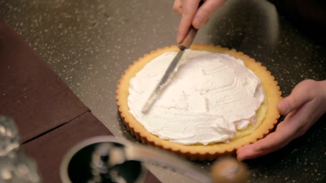 Spreading Whipped Cream on Pie