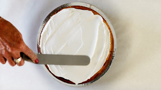 spreading whipped cream on top of fresh cheesecake - cake stock videos & royalty-free footage