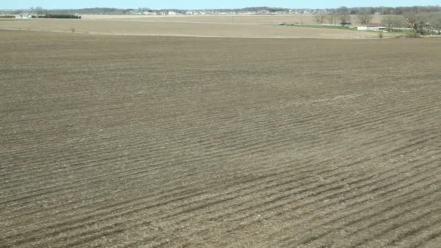 spring cornfield and planting panning aerial crane shot - crane shot stock videos and b-roll footage