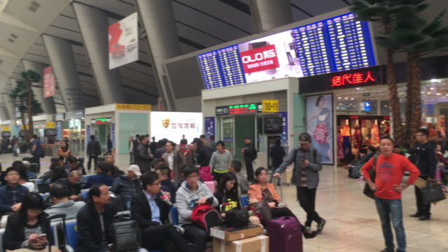 vídeos de stock, filmes e b-roll de spring festival rush will begin from jan 13 nearly 3 billion trips would be made during the 40day period up 22 per cent compared with last year - migrant worker