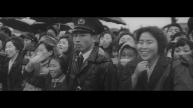 spring in shinanoji – crown prince akihito and crown princess michiko greeting spring lake suwa fishing nets trailing after boats crowd at japan... - crown prince stock videos & royalty-free footage
