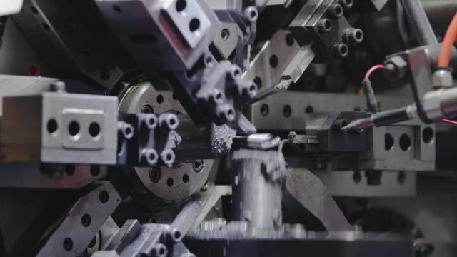 spring making machine produces small springs. - manufacturing machinery stock videos & royalty-free footage