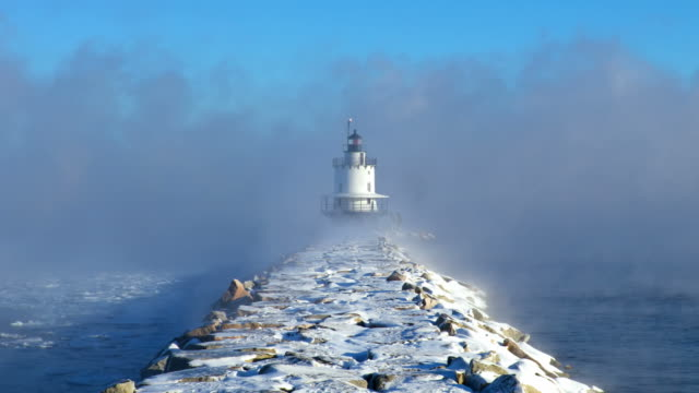 spring point ledge light in arctic sea smoke - jetty stock videos & royalty-free footage