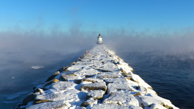 spring point ledge light in arctic sea smoke - lighthouse stock videos & royalty-free footage