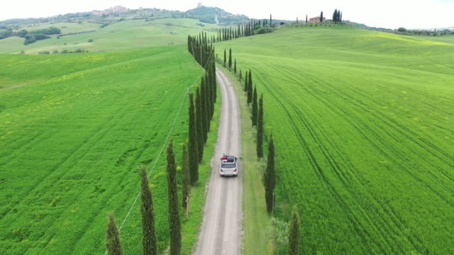 spring scenery of tuscany, italy (with car driving along the road) - tuscany stock videos & royalty-free footage