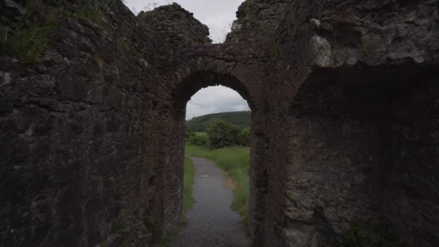 spring season countryside - rock of dunamese - ireland - arch stock videos & royalty-free footage
