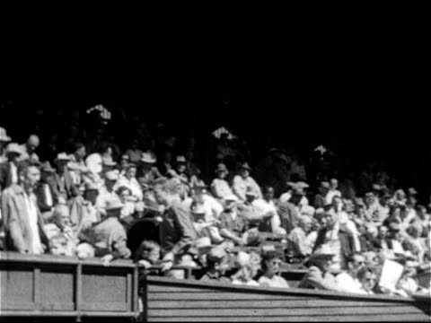 spring training exhibition game stands filled w/ fans people ms cleveland indians manager al lopez in jacket cap sunglasses - spring training stock videos & royalty-free footage