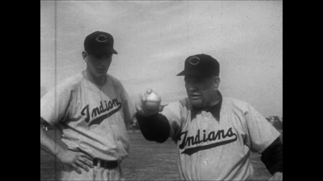 vídeos de stock e filmes b-roll de spring training fielding practice hank greenberg hits ball to jim lemon who catches and throws the ball gets advice from tris speaker / coach red... - camisola de basebol