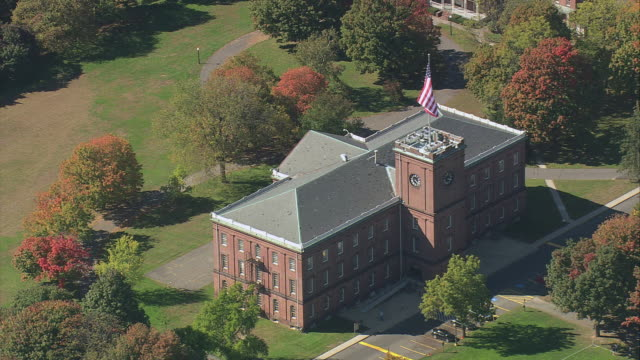 aerial springfield armory in parkland and trees with fall colors / springfield, massachusetts, united states - springfield massachusetts stock videos & royalty-free footage