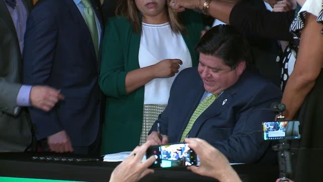 wgn springfield il us governor j b pritzker signs bill legalizing recreational marijuana on tuesday june 25 2019 - legalisation stock videos & royalty-free footage