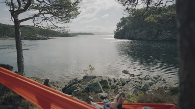 springtime in norway: adventures in nature outdoor on hammock - scandinavia stock videos & royalty-free footage