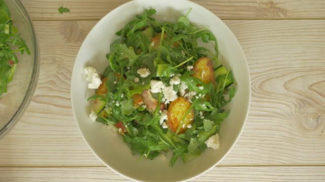 sprinkle feta flakes on top of summer potato salad - salad stock videos & royalty-free footage