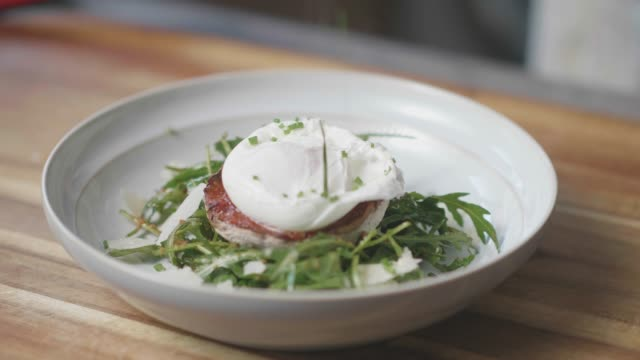 sprinkle fine chopped chives on top poaching egg,mushroom salad - chive stock videos & royalty-free footage