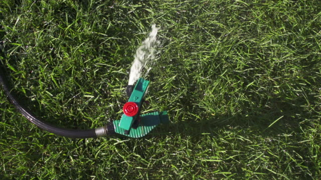 cu sprinkler spraying water in grass / farmington, connecticut, united states - sprinkler system stock videos & royalty-free footage