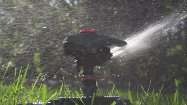 CU SLO MO Sprinkler spraying water in grass / Farmington, Connecticut, United States
