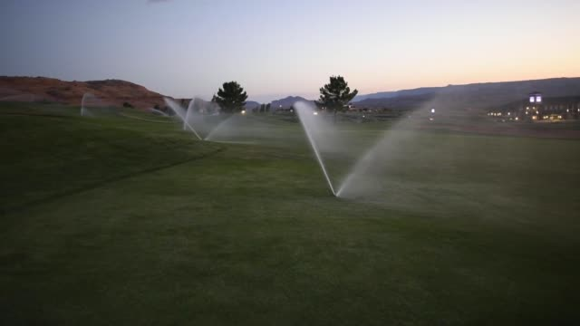 sprinklers are seen watering the lake powell national golf club in page arizona us on thursday june 25 2015 shots various cus and tilts of sprinklers... - lake powell stock videos and b-roll footage