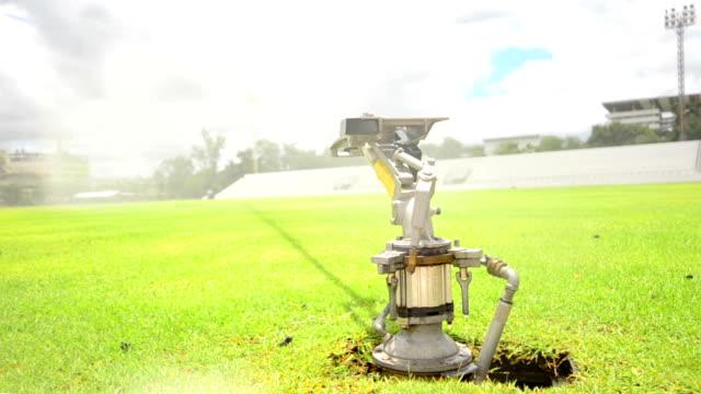 sprinklers in the stadium - vattenspridare bildbanksvideor och videomaterial från bakom kulisserna