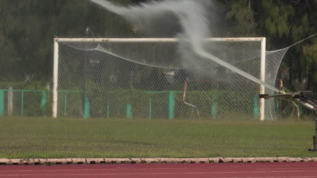 sprinklers on the football pitch - agricultural equipment stock videos & royalty-free footage