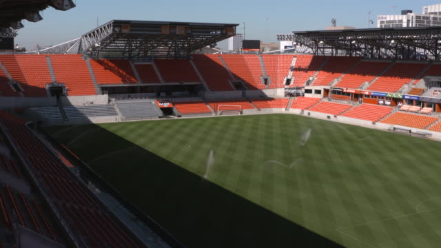 kiah sprinklers water the field at houston's bbva compass stadium an american soccerspecific stadium located in houston texas that is home to the... - major league soccer stock videos and b-roll footage
