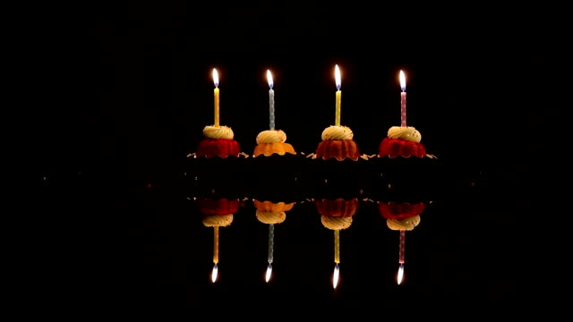 sprinkles dropping on cupcake with candle for birthday - candle stock videos & royalty-free footage
