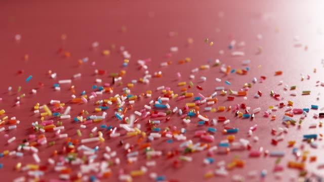 sprinkles falling down - sprinkling stock videos & royalty-free footage