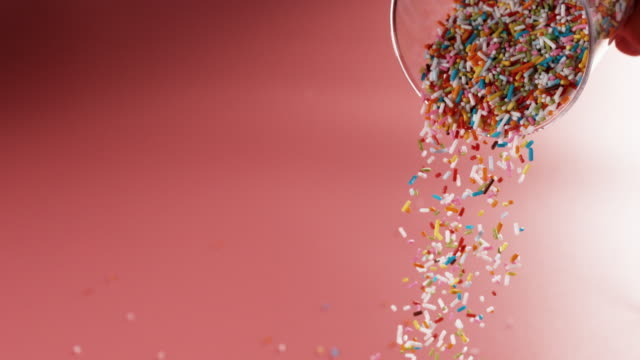 sprinkles falling from drinking glass - sprinkling stock videos & royalty-free footage