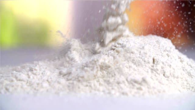sprinkling flour - flour stock videos & royalty-free footage