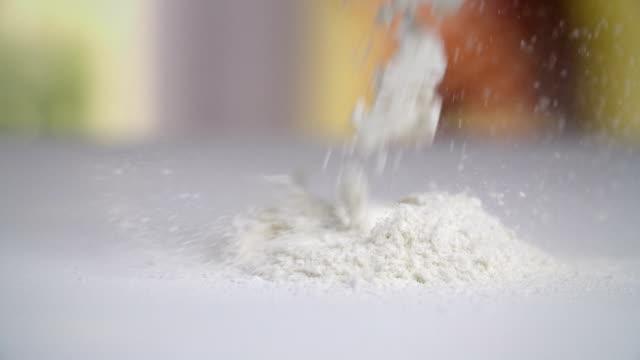 sprinkling flour - sprinkling stock videos & royalty-free footage