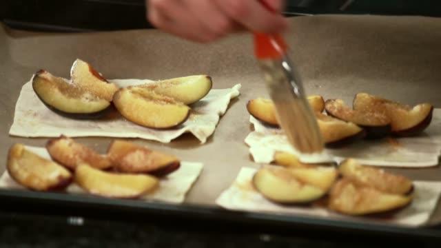 sprinkling sugar and cinnamon on plums - plum stock videos & royalty-free footage