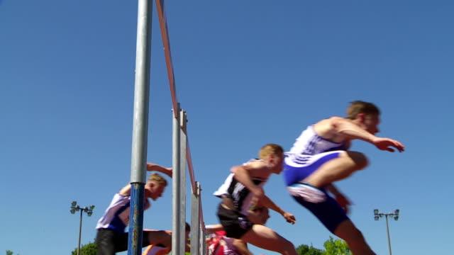 sprint hurdle race for men slo mo - hurdle stock videos & royalty-free footage