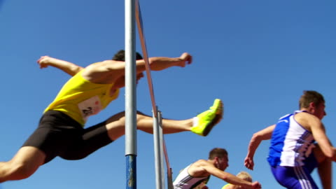 sprint hurdle race for men slo mo - track and field stock videos & royalty-free footage