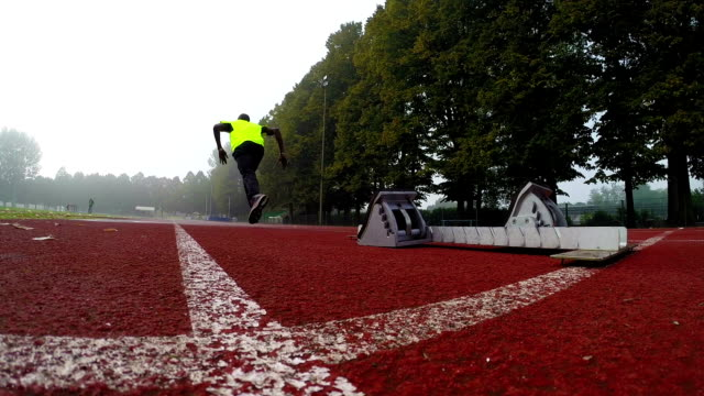 Sprinter runs off the starting block
